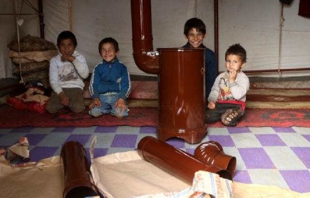 İHH'dan kamplara soba ve yakacak yardımı